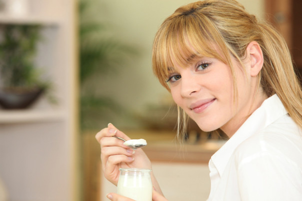 Woman eating yoghurt